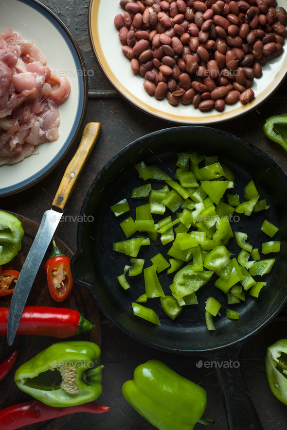 Ingredients for fajita and a knife on a cutting board. - Stock Photo - Images