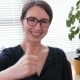 Well Done - a Laughing Businesswoman Shows the Thumbs Up Sign - VideoHive Item for Sale