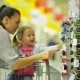 Happy Female Child with Her Pretty Beautiful Mother Choosing Sunglasses in the Supermarket. Cute - VideoHive Item for Sale