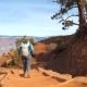 Woman With Backpack Hiking On Trekking Footpath In Grand Canyon Arizona USA - VideoHive Item for Sale