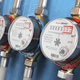 Row of water meters of cold and hot water on the wall background - PhotoDune Item for Sale