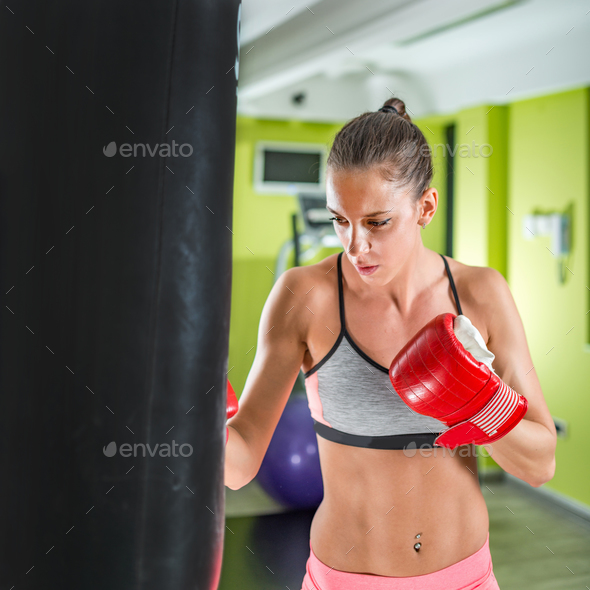 Woman exercising in the gym - Stock Photo - Images