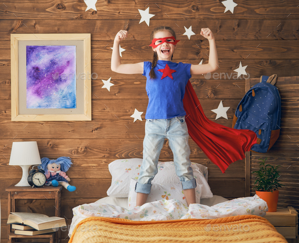 child playing superhero - Stock Photo - Images