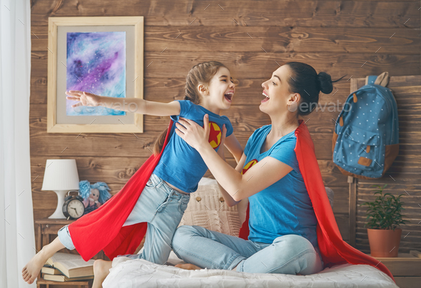 Girl and mom in Superhero costume - Stock Photo - Images
