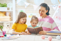Mom and children reading a book - PhotoDune Item for Sale