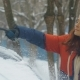Girl in Clearing the Car From Snow - VideoHive Item for Sale