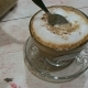 Woman Stirs Hot Cappuccino with a Spoon Tasty Coffee in Transparent Cup. Street Cafe in Bangkok - VideoHive Item for Sale