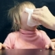 Mom with a Crying Child in His Hand with a Handkerchief Wipes His Snot - VideoHive Item for Sale