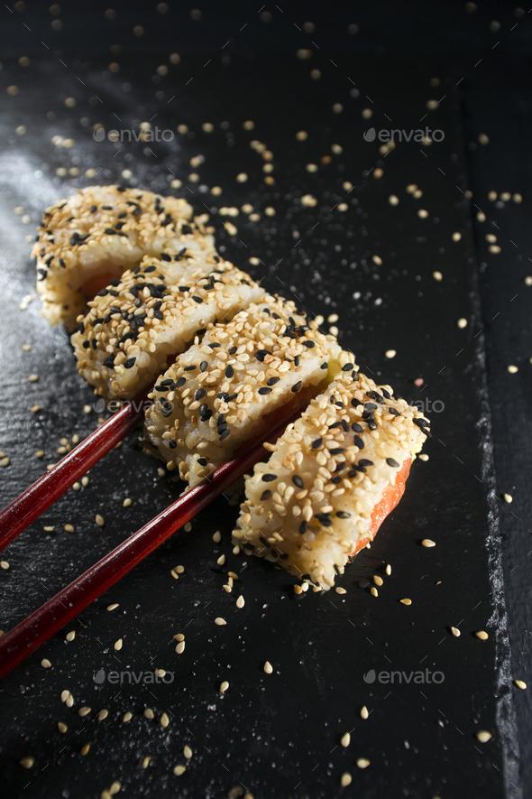 Sushi dish with chopsticks - Stock Photo - Images
