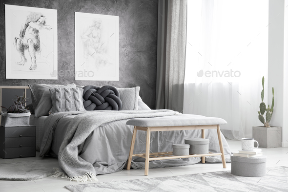 Drawings in monochromatic bedroom - Stock Photo - Images