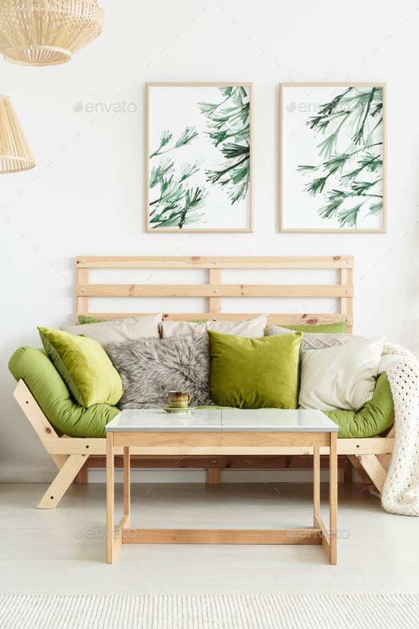 Wooden sofa with green cushions - Stock Photo - Images