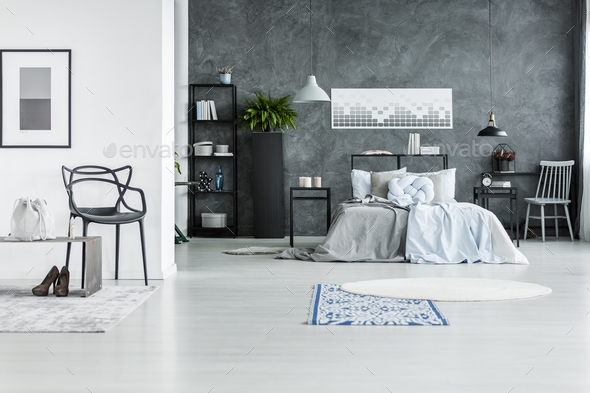 Monochromatic bedroom interior with chair - Stock Photo - Images