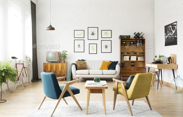 Armchairs in retro room interior - Stock Photo - Images