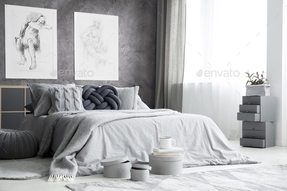 Drawings in bright bedroom interior - Stock Photo - Images