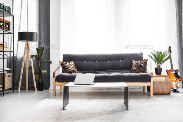 Settee in bright living room - Stock Photo - Images