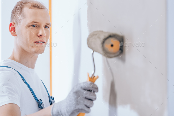 Worker using paint roller - Stock Photo - Images