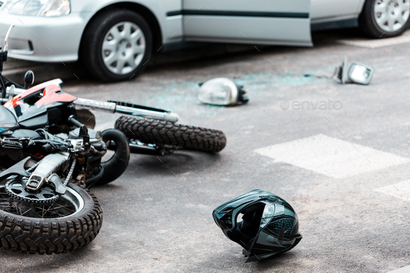 Overturned motorcycle after collision - Stock Photo - Images