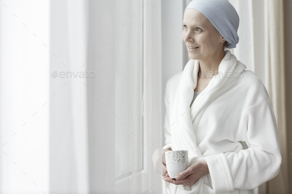 Smiling woman with cancer - Stock Photo - Images