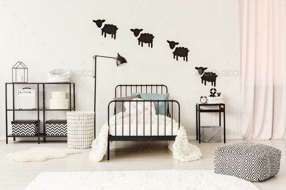 Teenager's bedroom with sheep stickers - Stock Photo - Images