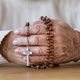 Senior's hands with red rosary - PhotoDune Item for Sale