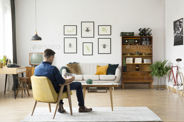 Man in retro living room - Stock Photo - Images