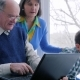 Happy Family, Grandparents with Grandchildren Play on Computer Near Big Window - VideoHive Item for Sale