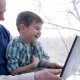 Laughing Boy with Grandfather with Laptop Sitting Together at Home - VideoHive Item for Sale