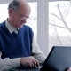 Older Man and Woman with Laptop Spend Time on Internet on Vacation in Room - VideoHive Item for Sale