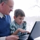 Online Shopping Through Laptop, Boy with Grandfather Choose Goods in Internet - VideoHive Item for Sale
