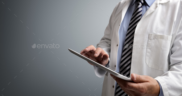 Doctor using digital tablet - Stock Photo - Images