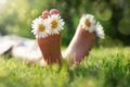 Child lying in meadow relaxing in summer sunshine - PhotoDune Item for Sale