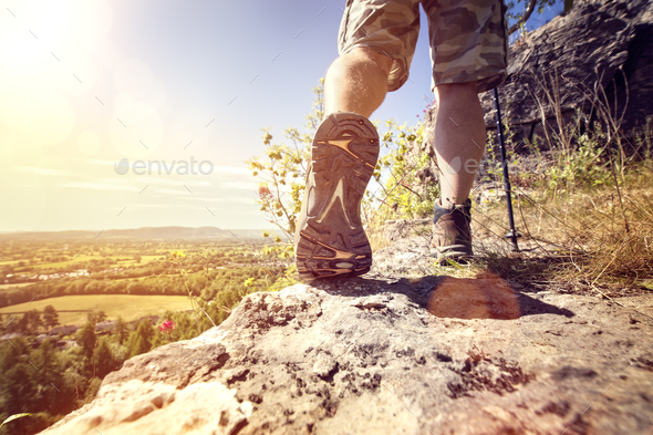 Hiking on a mountain trail - Stock Photo - Images