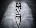 Wedding rings and heart shaped shadow over Bible - PhotoDune Item for Sale