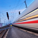 High speed passenger train on railroad track in motion - PhotoDune Item for Sale