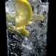 Water with Lemon and Ice in a Glass on a Black Isolated Background - VideoHive Item for Sale