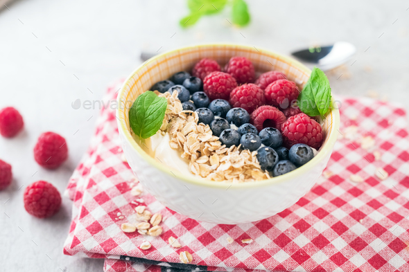 Yogurt with blueberry, raspberry and oatmeal flakes - Stock Photo - Images