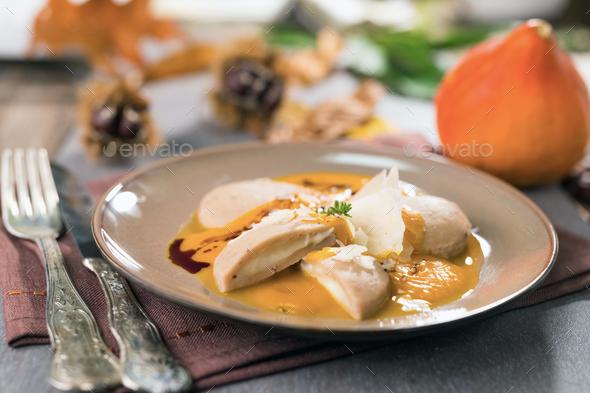 Chestnut gnocchi with pumpkin sauce - Stock Photo - Images