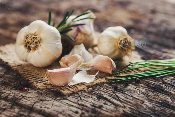 Fresh garlic on rustic background - Stock Photo - Images