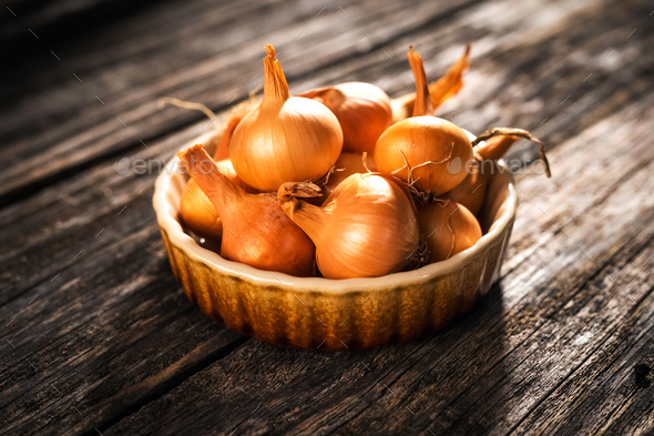 Fresh onion  on wooden table - Stock Photo - Images