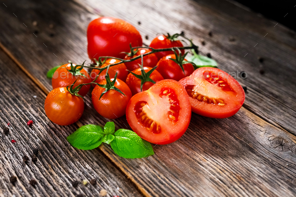 Fresh  tomatoes on rustic background - Stock Photo - Images