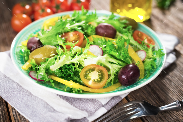 Fresh mixed salad on wooden backgeound - Stock Photo - Images