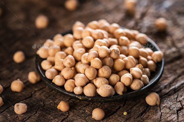 Organic chickpea on wooden  background - Stock Photo - Images