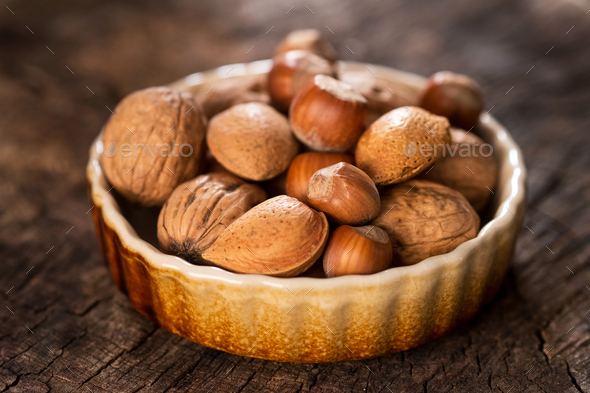 Mixed Nuts on Rustic Wooden Table - Stock Photo - Images