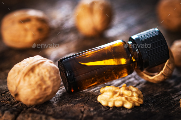 Walnuts oil on rustic wooden table - Stock Photo - Images