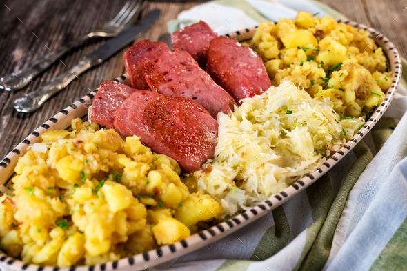Leberkaese with sauerkraut and potato - Stock Photo - Images