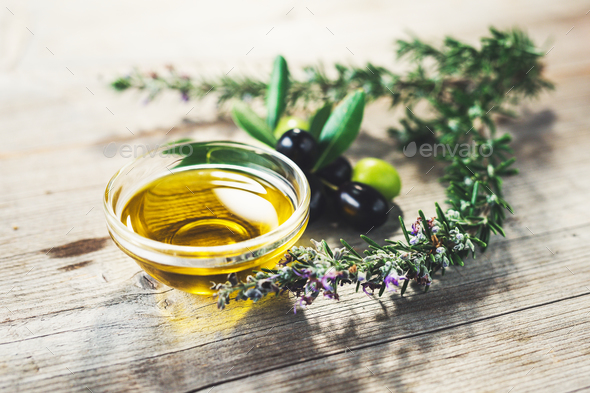 Olive oil with leaves and olives - Stock Photo - Images