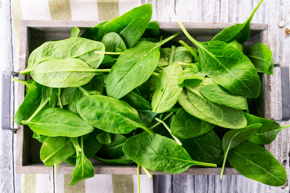 Fresh spinach on wooden background - Stock Photo - Images