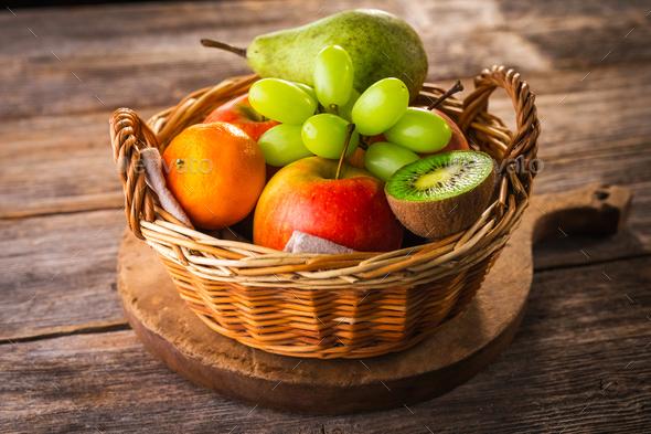 Fresh fruits on wooden background - Stock Photo - Images