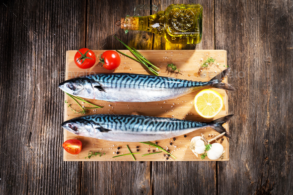 Fresh mackerel on wooden background - Stock Photo - Images