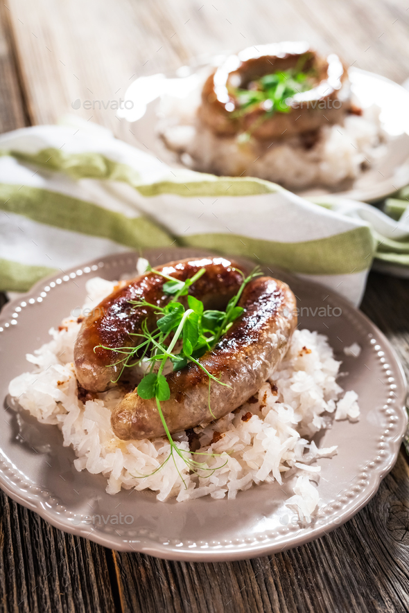 Sausage and sour turnips on rustic background - Stock Photo - Images